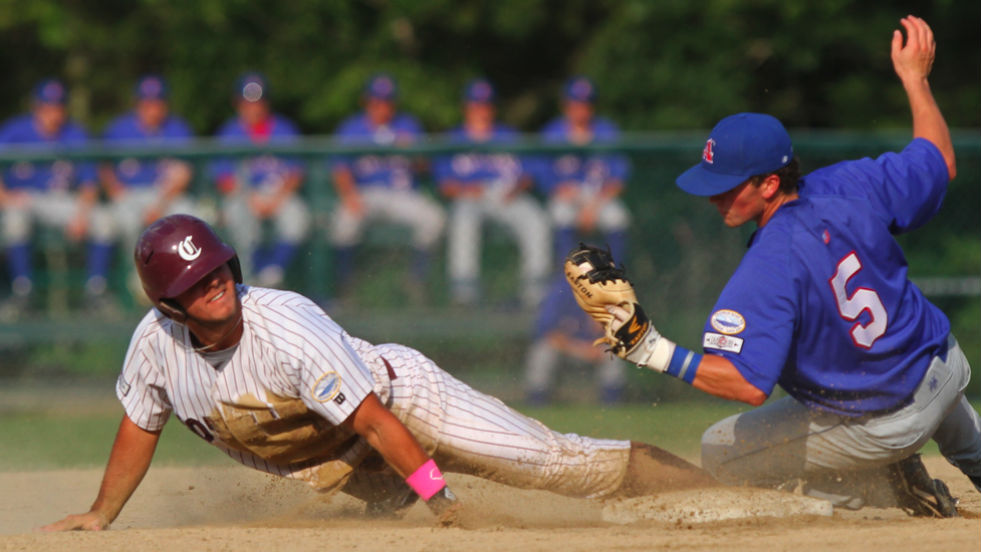 Max Schrock slides into second in Cotuit's game with Chatham.