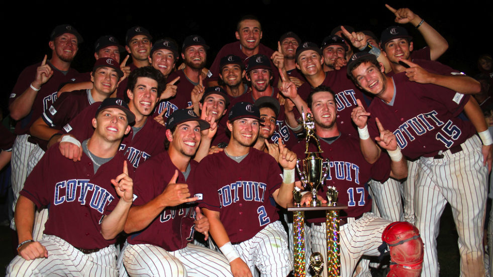 The Cotuit Kettleers show off their championship hardware.