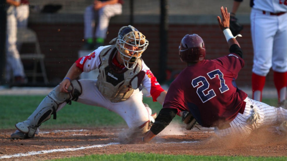 Brian Serven puts a tag on  a Cotuit runner in Wednesday's game.