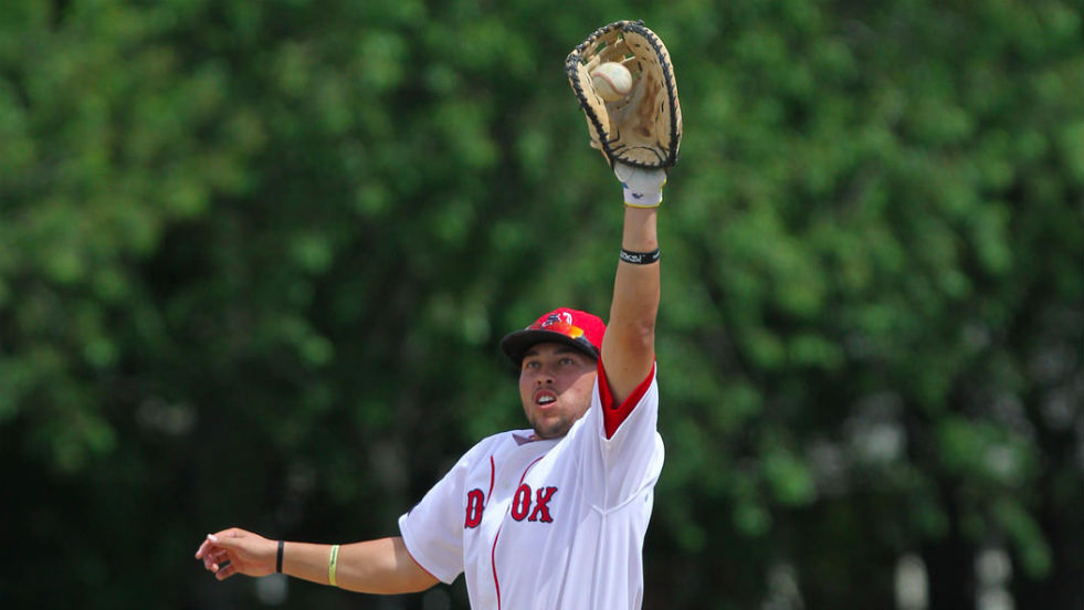 Brady Conlan catches a high throw at first during game one of Sunday's doubleheader.