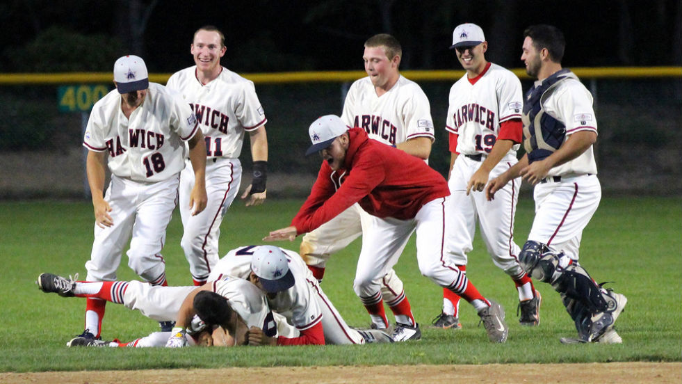 The Harwich Mariners celebrate their walk-off win on the Fourth of July. They also delivered a late comeback to win Monday.