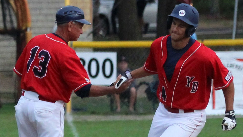 Gio Brusa gets a high five from Scott Pickler as he rounds third base after his first-inning home run Saturday night.