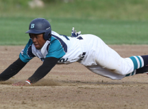 Marty Costes slides into second base.